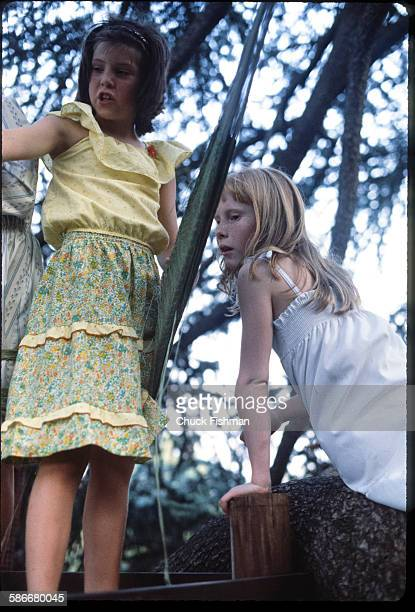 American First Daughter Amy Carter plays with an unidentified friend in her treehouse on the White House grounds Washington DC June 1978