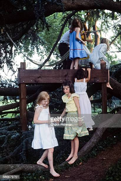American First Daughter Amy Carter plays with unidentified friends in her treehouse on the White House grounds Washington DC June 1978