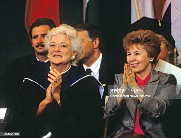 American First Lady Barbara Bush and Wife of the President of the Soviet Union Raisa Gorbachev applaud as they attend graduation ceremonies at...