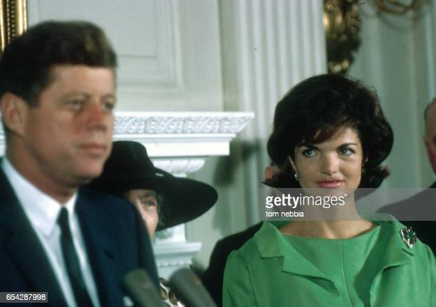 American First Lady Jacqueline Bouvier Kennedy listens as her husband American politician US President John F Kennedy speaks during an unspecified...