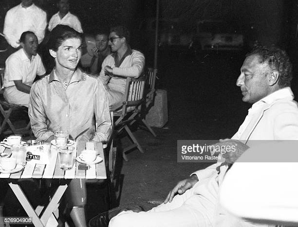 American First Lady Jacqueline Kennedy with Italian tycoon Gianni Agnelli principal shareholder of Italian carmaker Fiat sit at a bar in Ravello...