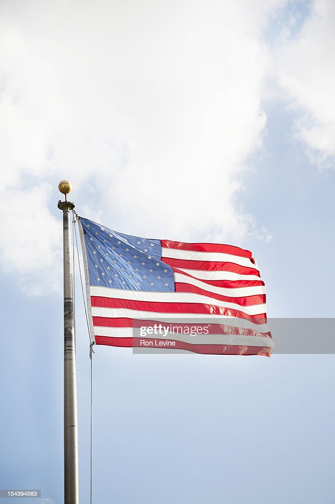 American flag against a blue sky : Stock Photo
