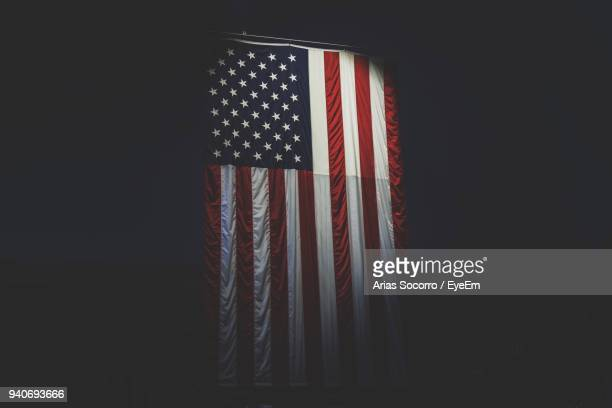 american flag against black background - patriotic stock pictures, royalty-free photos & images