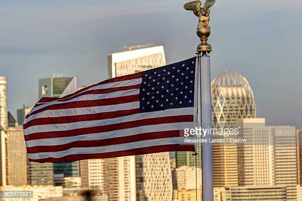 American Flag Against Cityscape