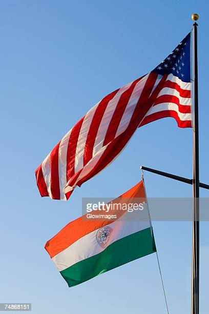 american flag and an indian flag fluttering - indian flag stock pictures, royalty-free photos & images