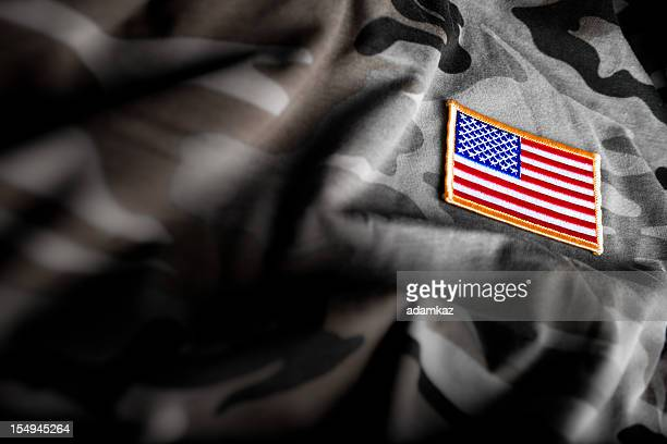 american flag and camoflage (military series) - armistice day stock photos and pictures