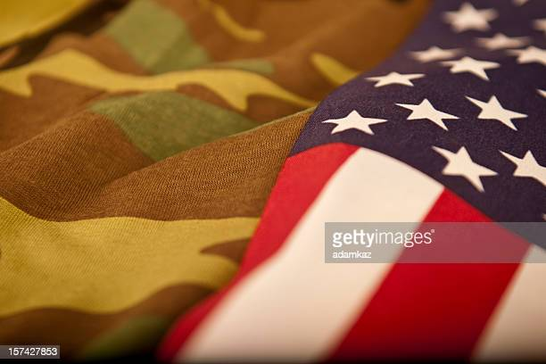 american flag and camoflage (series) - camouflage clothing stock pictures, royalty-free photos & images