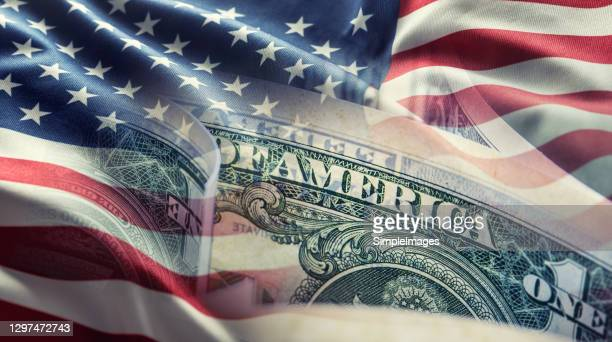 american flag and dollar banknotes - business background. - finance and economy stock pictures, royalty-free photos & images