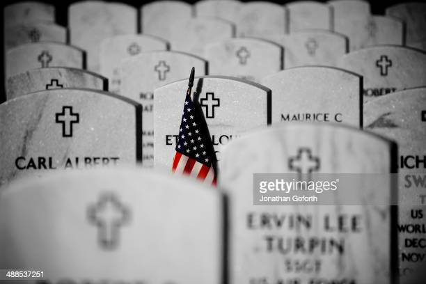 CONTENT] American flag and headstones at a military cemetery at the Mill Springs National Cemetery in KY
