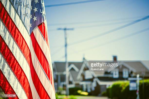 american flag and neighborhood - patriotic stock pictures, royalty-free photos & images