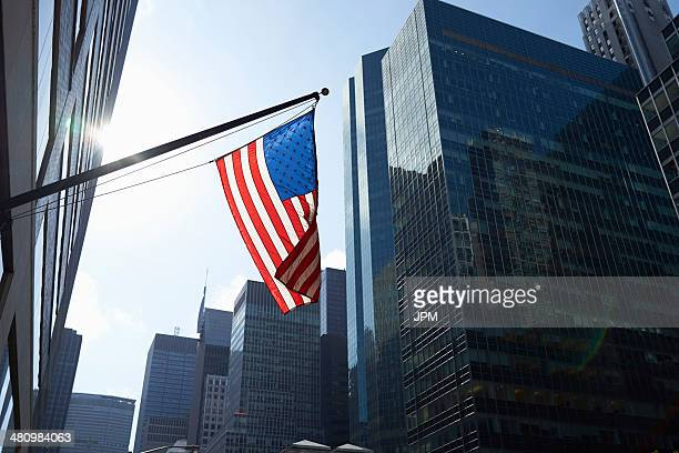American flag and office buildings, Manhattan, New York, USA