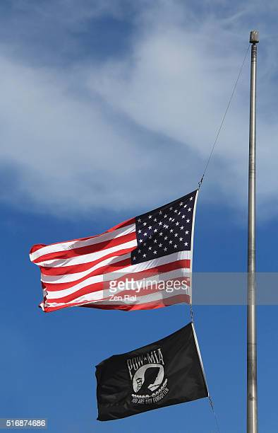 american flag and pow mia flag fly half staff - half mast stock photos and pictures