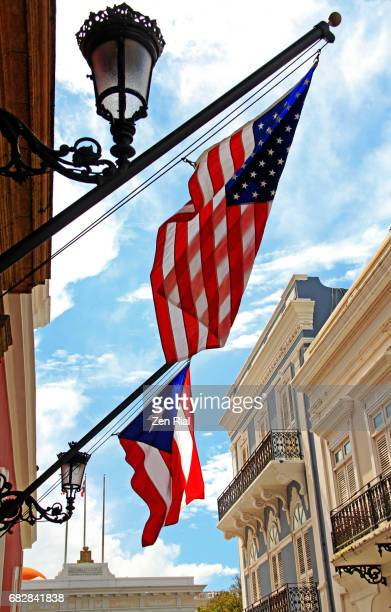 American flag and Puerto Rican flag fly side by side in San Juan, Puerto Rico