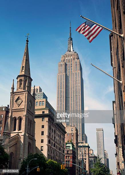 american flag and the empire state building, new york, america, usa - empire state building stock pictures, royalty-free photos & images