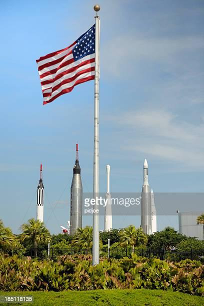 american flag at rocket park nasa kennedy space center - nasa kennedy space center stock pictures, royalty-free photos & images