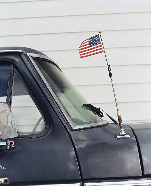 American flag attached to car antenna