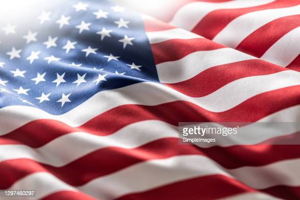 american flag blowing in the wind. - politics stock pictures, royalty-free photos & images