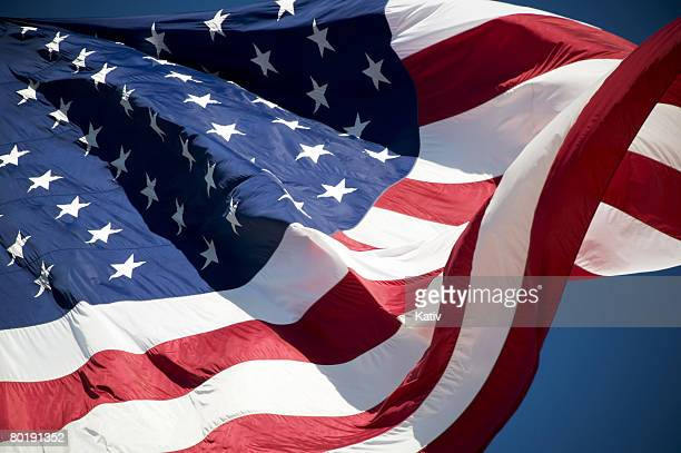 American flag blowing in wind.