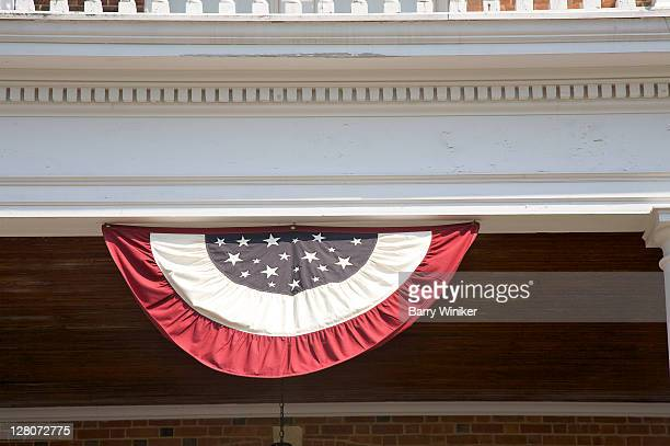 American flag bunting hanging on front porch, Lenox, Massachusetts, The Berkshires, U.S.A.