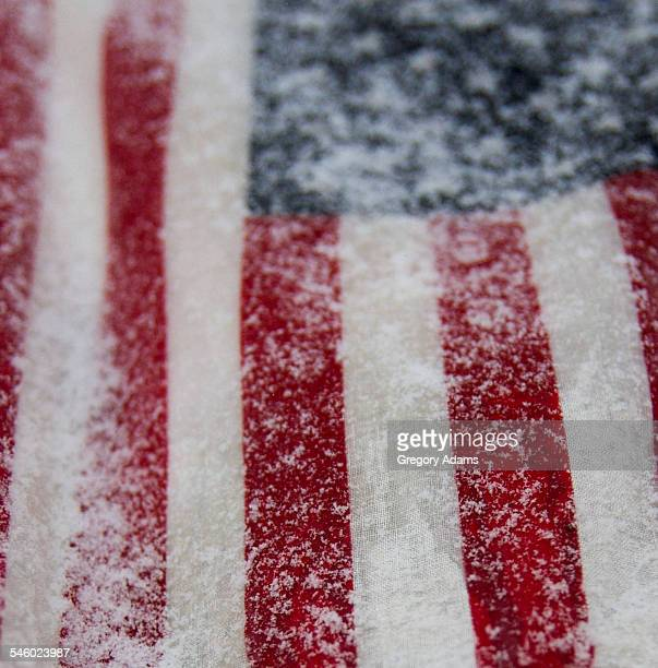 American flag covered in snow