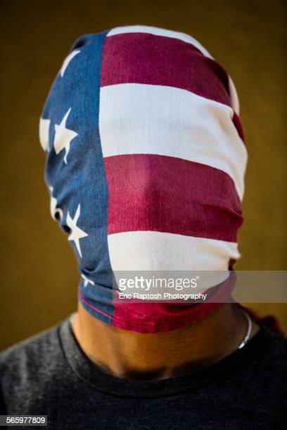 American flag covering face of mixed race man