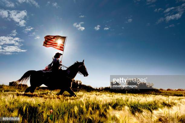 american flag cowgirl - patriots stock photos and pictures