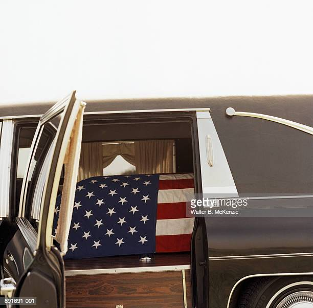 american flag draped over coffin in hearse - flag draped coffin stock pictures, royalty-free photos & images
