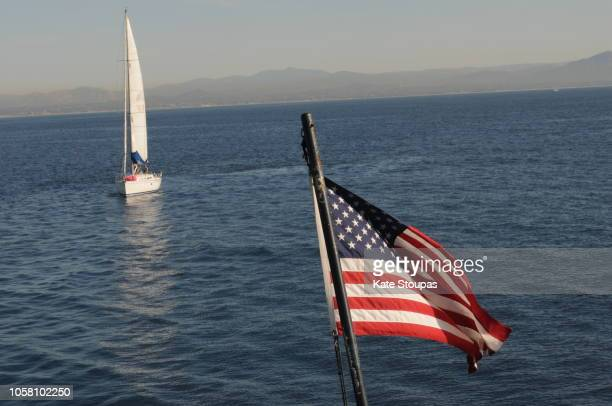 american flag flying from a boat - american flag ocean stock pictures, royalty-free photos & images