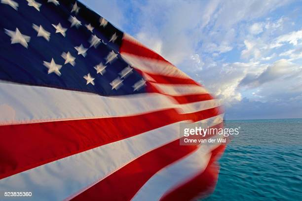 american flag flying in the bahamas - american flag ocean stock pictures, royalty-free photos & images