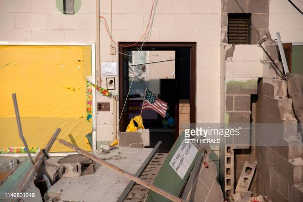 A American flag flys in a damaged class room of a school in Dayton Ohio on May 28 after powerful tornadoes ripped through the US state overnight...