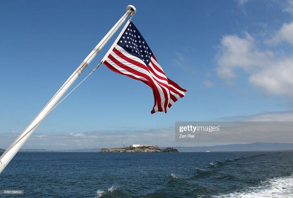 American Flag Frames Alcatraz Island In San Francisco Bay California ...