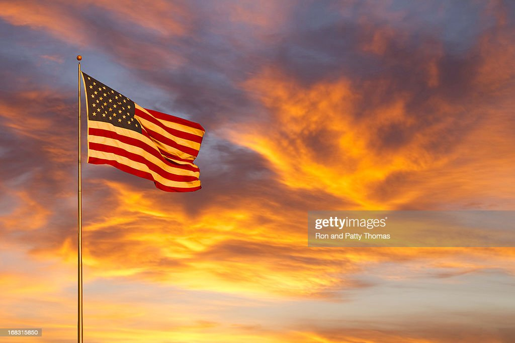 American flag glow in sunset (P) : Stock Photo