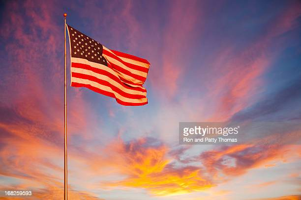 american flag glows in the sunset. (p) - stars and stripes stock pictures, royalty-free photos & images