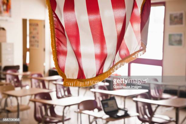 american flag hanging in classroom - education stock pictures, royalty-free photos & images