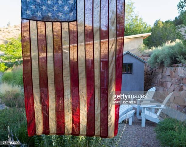 American flag hanging near house