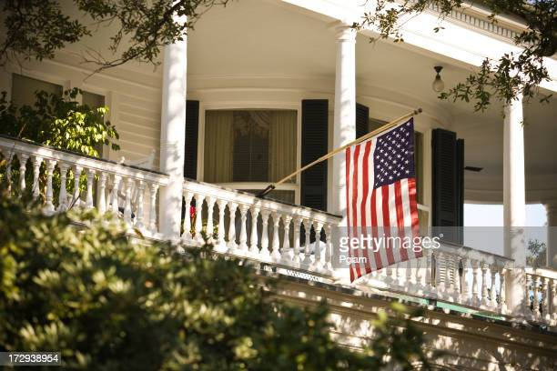 American flag hangs from a balcony