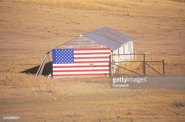 American Flag Hung on an Old Barn