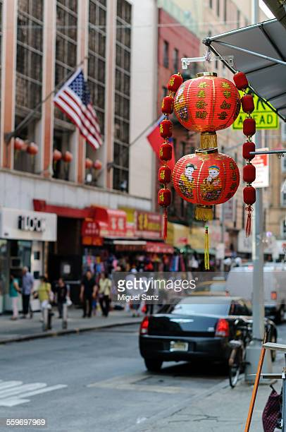 american flag in chinatown, new york - canal street manhattan stock pictures, royalty-free photos & images