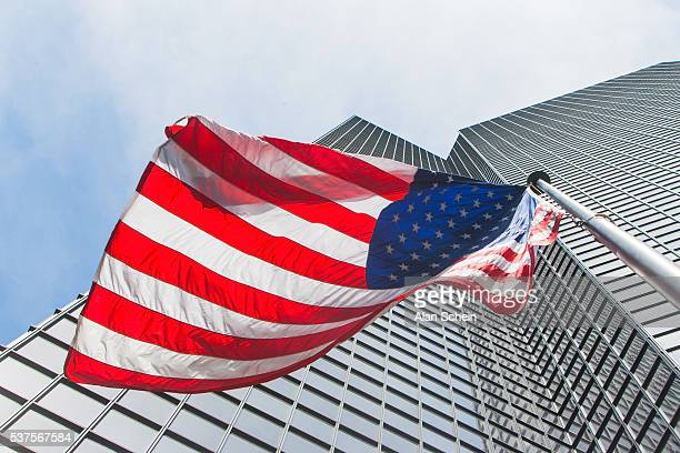 american flag in front of building, nyc