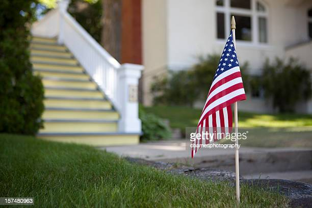 american flag in front of house - flag day stock pictures, royalty-free photos & images