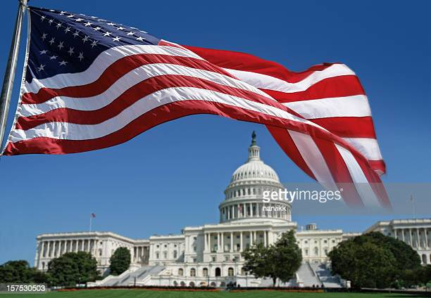 american flag in front of the capitol - capitol hill stock pictures, royalty-free photos & images