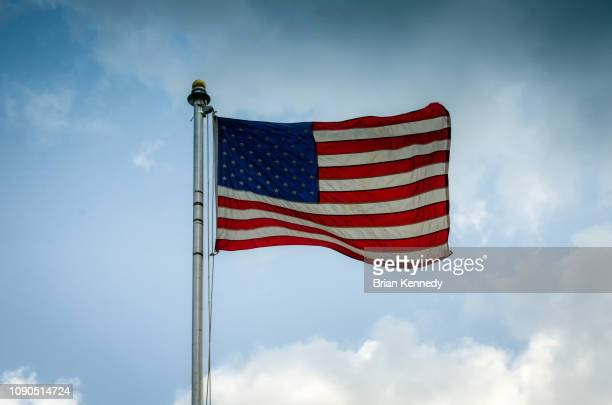 american flag in the sky - flagpole stock pictures, royalty-free photos & images