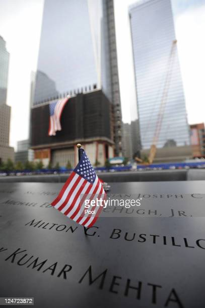 American flag is placed on a name of a victim on the North Pool of the 9/11 Memorial during the tenth anniversary ceremonies of the September 11 2001...