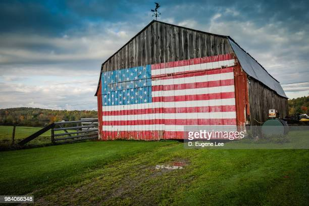 american flag on a barn. - patriotic stock pictures, royalty-free photos & images
