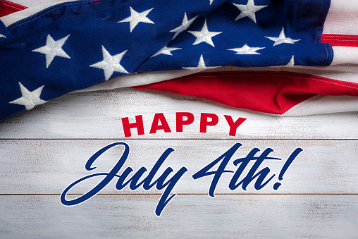 American flag on a white worn wooden background with July 4th Greeting 956487244