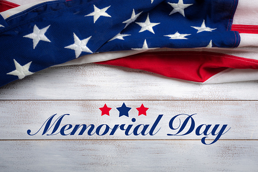 American flag on a white worn wooden background with memorial day greeting 956473602