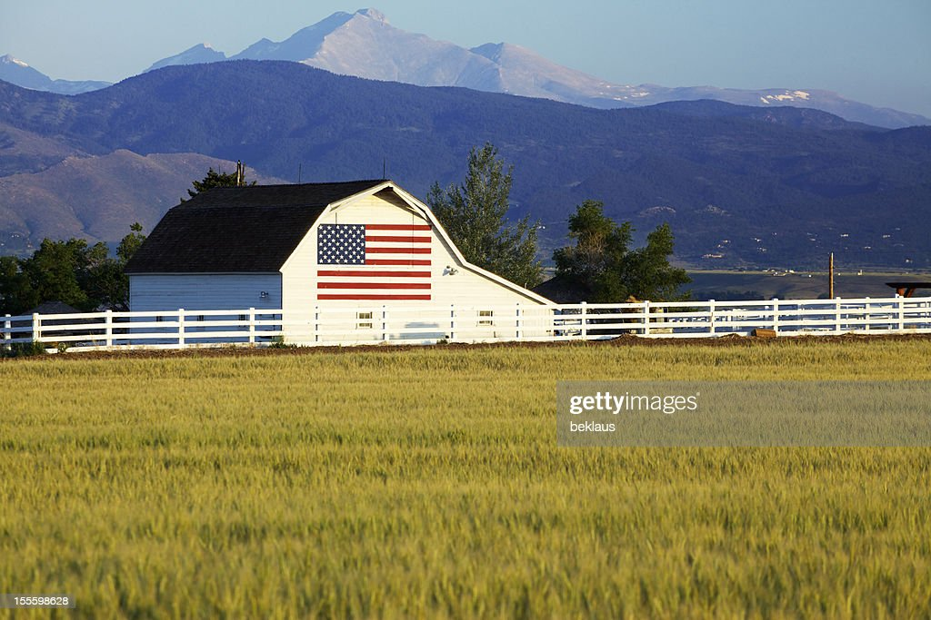 American Flag on Barn in Rocky Mountains : Stock Photo