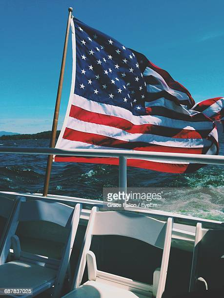 american flag on boat railing - american flag ocean stock pictures, royalty-free photos & images