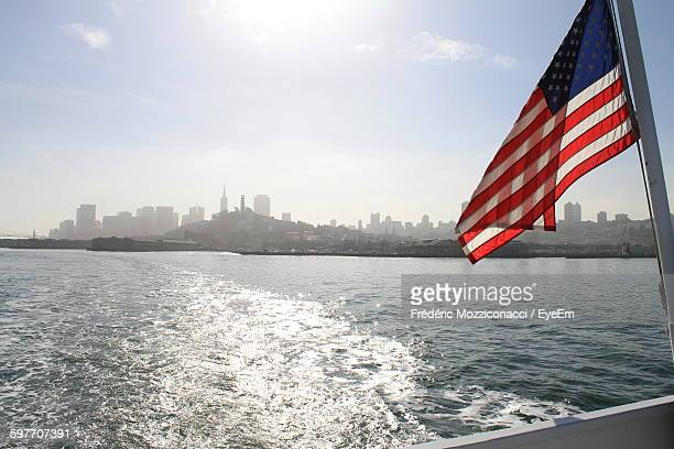 american flag on boat sailing in sea - american flag ocean stock pictures, royalty-free photos & images