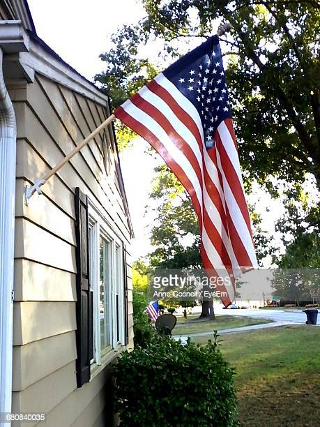 American Flag On House Wall